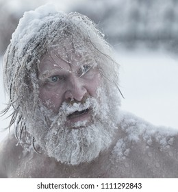 Bearded man, after bathing in the snow