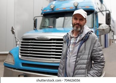 Bearded man against retro styled truck