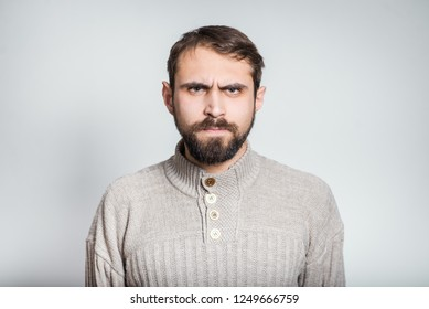 bearded man angry, close-up over background