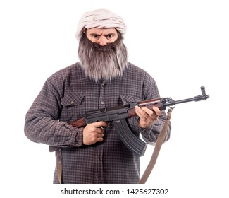 The bearded man armed with kalashnikov isolated on a white background. Muslim warrior with automatic weapon.