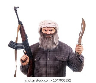 The bearded man armed with kalashnikov and knife isolated on a white background. Muslim warrior with automatic weapon.