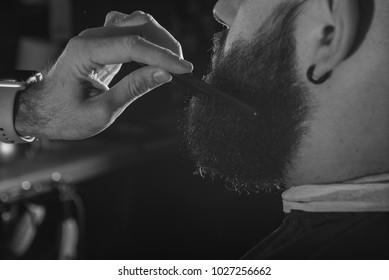 Bearded man. Barber scissors and straight razor, barber shop. Vintage barbershop, shaving. Mustache men.Brutal guy. Barbershop Theme