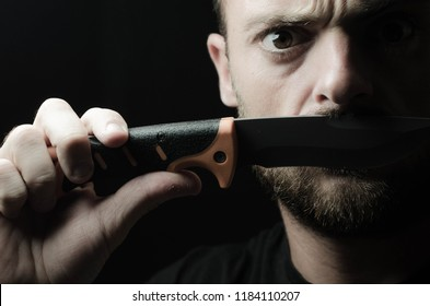 Bearded man with a blade