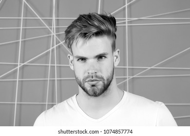 Bearded man with blond hair and haircut. Macho with beard on unshaven face. Handsome guy with healthy young skin face. Hair care in salon or barbershop. Mens beauty and skincare, black and white