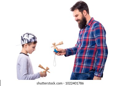 bearded man and boy playing with kendama on white background