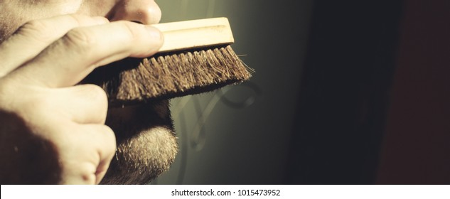 bearded man with a brush
