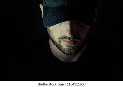 bearded man in a cap and a hood