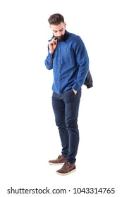 Bearded man carrying bomber jacket over the shoulder looking down with hand in pocket. Full body isolated on white background.
