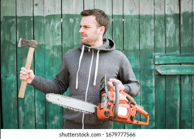 bearded man with chainsaw and ax