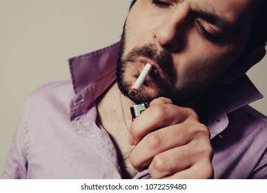 Bearded man with the cigarette