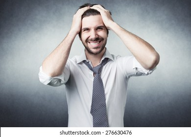 bearded man confused with shirt on grey background