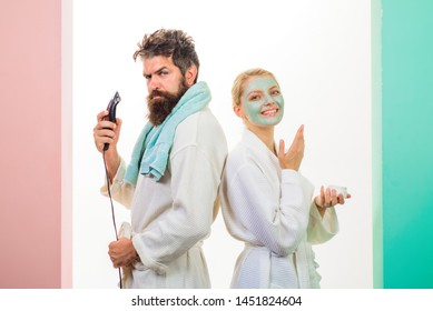 Bearded man with electric shaver. Cosmetic facial mask. Morning treatments. Health. Morning. Morning routine. Family life. Husband and wife. Morning procedures.