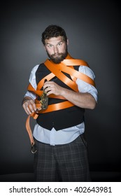 Bearded man entangled in security belt