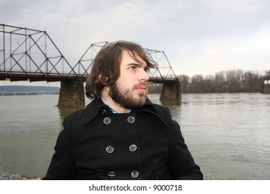 Bearded man in front of river.  Shot in Harrisburg, PA.