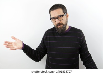 Bearded man with glasses on isolated white background clueless and confused with open arms, no idea and doubtful face