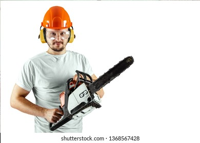 A bearded man in a helmet holding a chainsaw on a white background. Concept building, contractor, repair, lumberjack.