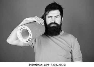 Bearded man hipster with fitness mat. Sporty man training in gym. Sport mat equipment. Athletic regime. Health and diet. Sport success. man workout with fitness mat. fitness coach. fitness regime.