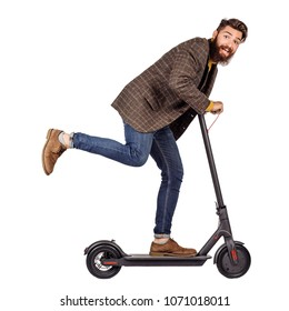bearded man holding the electric scooter and riding it while feeling delighted. image on white background