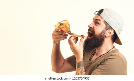 Bearded man holds piece of pizza in hands. Satisfed guy in green shirt enjoy tasty pizza. Man with beard and mustache enjoying slice pizza. Happy hungry man eating pizza and showing thumbs up gesture.