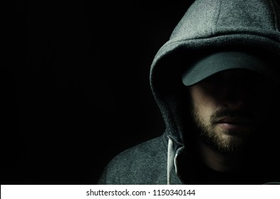 Bearded man in a hood
