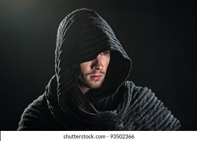 a bearded man in a hood