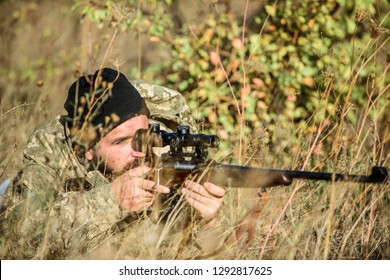 Bearded man hunter. Military uniform fashion. Army forces. Camouflage. Hunting skills and weapon equipment. How turn hunting into hobby. Man hunter with rifle gun. Boot camp. Military action