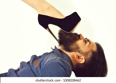 bearded man, long beard, brutal caucasian hipster with moustache on serious face with female sexy leg in fashionable shoes isolated on white background getting haircut in blue shirt