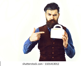 bearded man, long beard, brutal caucasian hipster with moustache holding lunch box with serious face isolated on white background