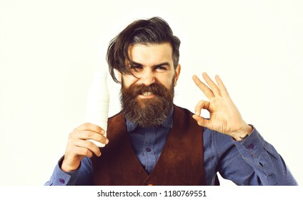 bearded man, long beard, brutal caucasian hipster with moustache holding bottle of kefir or yoghurt with happy face isolated on white background