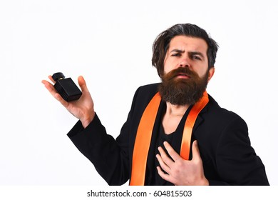 Bearded man, long beard. Brutal caucasian satisfied hipster with moustache have acid orange tie on suit and holding perfume isolated on white studio background