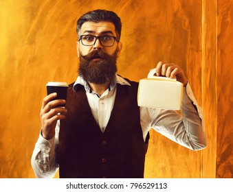 Bearded man, long beard. Brutal caucasian unshaven surprised hipster with glasses and moustache holding black plastic coffee cup or mug and meal box on brown studio background