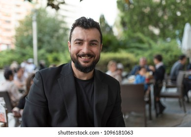 Bearded man looking at camera and smiling
