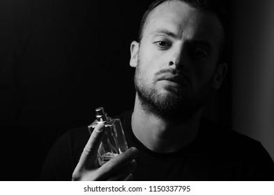 bearded man with perfume
