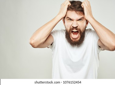 a bearded man pulls out his hair, emotions