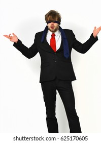 Bearded man, short beard. Caucasian stylish surprised macho with moustache in elegant suit, red tie, white shirt with blindfold eyes posing at studio isolated on white background