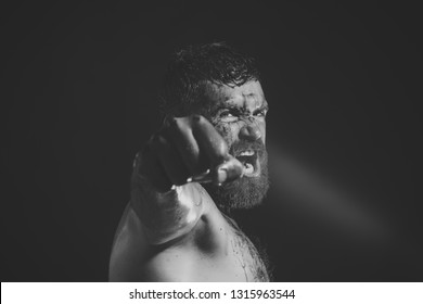 Bearded man show bloody fist on black background. Power, might, magic. Sport, boxing, fighting. Hipster with beard, mustache shout with anger. Halloween, holidays celebration, copy space