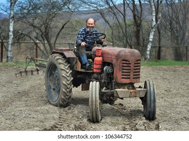 The bearded man sits on a tractor