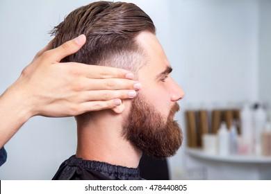 Bearded man sitting in the barbershop