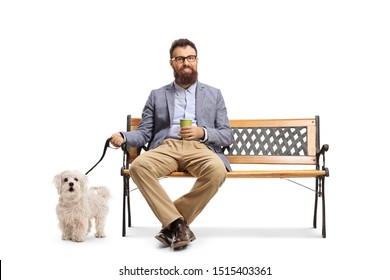 Bearded man sitting on a bench with a cup of take away coffee and a dog on a leash isolated on white background