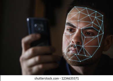 Bearded Man with smartphone using face ID recognition system.