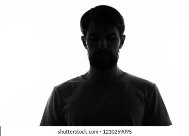 bearded man stands in the shade