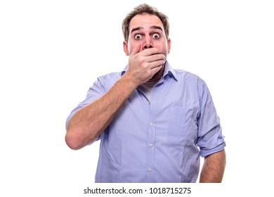 Bearded man is startled and holds his hand in front of his mouth
