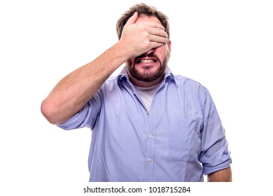 Bearded man is startled and holds his hand in front of his eyes
