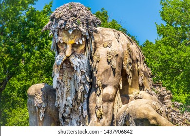 bearded man statue colossus of Appennino giant statue public gardens of Demidoff Florence Italy close up .