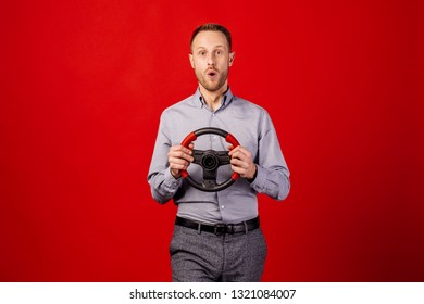 Bearded man with a steering wheel, car drive concept.