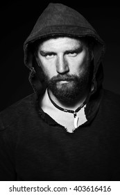 Bearded man in studio on black background