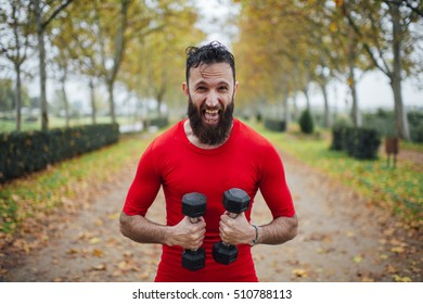 bearded man takes exercise in the park