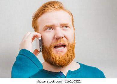 bearded man talking on the phone