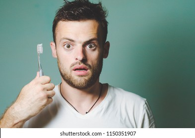 Bearded man with a toothbrush