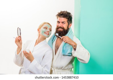 Bearded man with toothbrush. Cosmetic facial mask. Morning treatments. Health. Morning. Morning routine. Family life. Husband and wife. Morning procedures. Awakening.